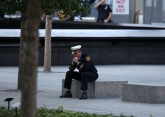 A firefighter from Kearney, N.J., paused before the ceremony in Lower Manhattan on Tuesday commemorating the 11th anniversary of the attack on the World Trade Center.