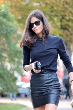 Classic black crew gives short leather skirt sophistication. Great combo…