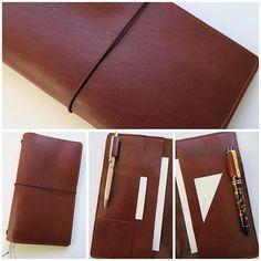 Regular size pocketed traveler's notebook in just Jaffa. Paperflower.com.au #planner #plannerjunkie #planneraddict #plannergirl #journal #midori #fauxdori #leatherjournal #leatherplanner