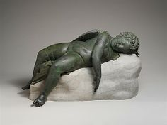 "Bronze statue of Eros sleeping, 3rd-2nd century B.C. Hellenistic period. Greek. The Metropolitan Museum of Art, New York. Rogers Fund, 1943 (43.11.4) | Trace the evolution of the image of Eros, the Greek god love, in the ""Sleeping Eros"" exhibition centered on this statute. This exhibition is on view until June 23, 2013."