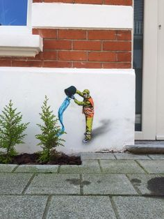 Belgian artist Jaune on the streets of Oostende, Belgium. Via StreetArtNews.net