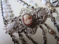 ethereal - antique cameo assemblage rosary necklace with joan of arc by the french circus Rosary Necklace, Rosary Beads, Diy Jewellery, Handmade Jewelry, Joan Of Arc, Religious Jewelry, Vintage Rhinestone, Ethereal, Jewelry Ideas