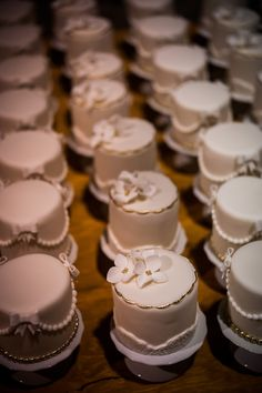 Individual cakes (1for each table) then one slightly larger cake for bride and groom to cut.  Ask each table to help cut the cake with you.