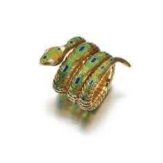 Gold, enamel and diamond Serpenti bracelet-watch, Bulgari. Designed as a snake, decorated with blue, green and yellow enamel, the eyes set with pear-shaped diamonds, the mouth opening to reveal a circular watch dial signed Jaeger LeCoultre.