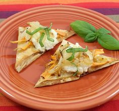 """Print Recipe Description:Start the event of on the right foot with an appetizer all of your guests will enjoy.Ingredients: 10 sheets Athens® Fillo Dough (9"""" x 14""""), thawed 2 tablespoons butter 1 1/2 cups onion, sliced 4 ounces feta cheese 8 ounces ricotta cheese 1 tablespoon fresh basil, chiffonade 1 small sweet potato 1 egg …"""