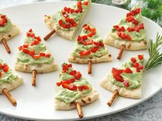 Christmas trees are just pita wedges spread with a mixture of fat-free sour cream, guacamole, parsley, garlic and pepper; pretzel sticks; and chopped red bell pepper
