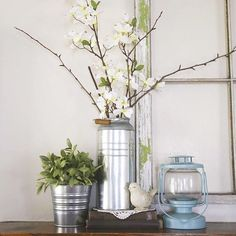 Joining @junquecottage and her #galvanizedhome. I usually end up putting some kind of foliage or flower in it. #galvanizedmetal #greenery #manteldecor #mantel #spring
