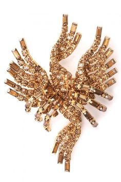 Beautiful 1950s Hattie Carnegie brooch entirely covered in gold coloured circular and baguette rhinestones, in a shape reminiscent of the phoenix.