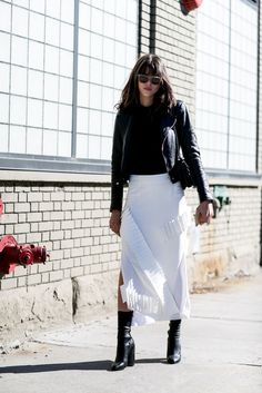 A white fringe #skirt, moto #jacket, and black ankle #boots. #fashion #style
