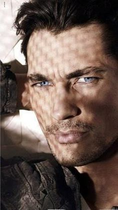 David Gandy shot that I rate a 10....love the intensity in his eyes..and how blue they are. Love the stubble and how that accentuates his lips...and he has a hint of frowny face.