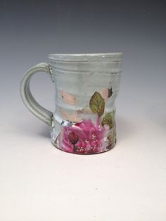 d8df3a7e059 Cup with green and white glaze poppies and platinum by rothshank