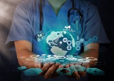 Medical Doctor holding a world globe in her hands as medical network concept