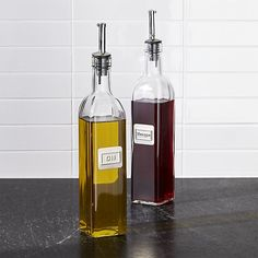 Sale ends soon. Shop Oil and Vinegar Bottle Set. Store and pour your favorite oil and vinegar with these high-style glass bottles featuring sophisticated stainless-steel nameplates, airtight silicone tops and stainless pouring spouts with hinged caps.