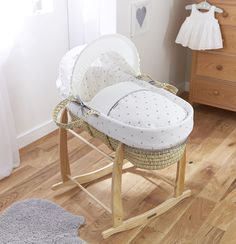 A British designed and made Palm Moses basket, featuring stunning embroidered grey hearts, removable, adjustable hood, mattress & coverlet. It just doesn't get better than this!