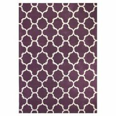 """Add a pop of pattern to your living room or den with this hand-tufted wool rug, showcasing a quatrefoil trellis motif in lilac.  Product: RugConstruction Material: 100% WoolColor: PurpleFeatures: Hand-tuftedPile Height: 0.5"""" Note: Please be aware that actual colors may vary from those shown on your screen. Accent rugs may also not show the entire pattern that the corresponding area rugs have.Cleaning and Care: Regular vacuuming and spot cleaning recommended. Rug pad recommended for use on…"""