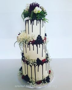 "10"" chocolate mud filled with chocolate ganache and salted caramel, 8"" chocolate cake filled with chocolate italian meringue and 6"" chocolate cake filled with ferrero rocher. Decorations white ganache with florals and fresh berries"