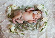 Baby in flowers, lace blanket, delicate. #babyphotography #grandrapidsbabyphotographer #grandrapidsphotographer #grandrapidsfamilyphotographer