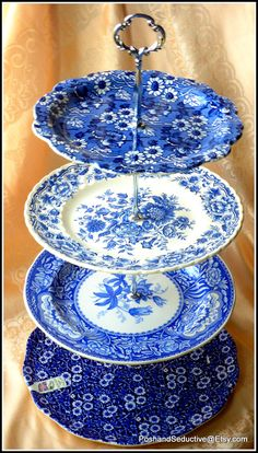 """Signature bespoke handmade tiered cake stand featuring best samples of English made branded blue and white transferware large cake and dinner plates by Burleigh """"Blue Calico"""", Spode """"Blue Room Collection"""" floral pattern and Ridgway """"Clifton"""" floral pattern made in Staffordshire makes this creation outstanding and supports Best of British Old Victorian afternoon tea tradition. Thumbs up!!! #Staffordshirechina #cakestand #blueandwhitechina #Cambridge #BestofBritish"""