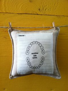 tooth fairy pillow with chart for marking which tooth fell out and when. pocket on the back for tooth/money.