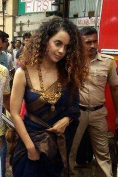 Kangna Ranaut is clicked here at the Ganpati pandal 'Lalbaug Cha Raja'. Kangna looked lovely in a blue-gold saree and gold jewellery. Saree Blouse Neck Designs, Saree Blouse Patterns, Priyanka Chopra, Kareena Kapoor, Deepika Padukone, Stylish Blouse Design, Saree Trends, Blue Saree, Saree Models