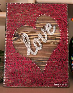 "String Art DIY Crafts Kit. Save 10% off the purchase price of this Heart String Art Kit by clicking on the picture, visiting String of the Art's Etsy page, and using the Coupon Code ""PinLove."" Heart Love String Art in Pink Embroidery Floss and distressed painted wood board"