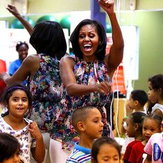Michelle Obama busts a move with a group of kids Tuesday during a surprise visit to a YMCA in Orlando, Fla., where the First Lady spread a healthy message as part of her Let's Move initiative.