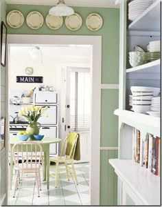 So many fun details I love in this country kitchen. From the diamond pattern stenciled on the floor to the mix matched color pallet.
