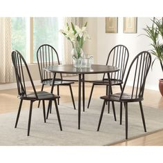 Ultra modern and perfect for the space-limited breakfast nook or dining room, this five piece set provides urban elegance with a hint of traditional appeal. The wood top provides ample space while the metal legs are durably supportive.