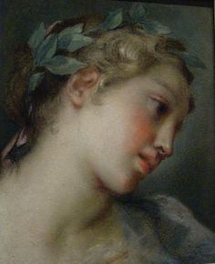 A Muse (ca. 1725).Rosalba Carriera (Italian, 1675-1757).Pastel on laid blue paper. Carriera rendered the porcelain skin, flushed cheeks, and wavy hair with subtly blended pastel colors, creating a soft, velvety surface. This delicate head crowned by soft curls and an ivy wreath was one of many idealized images Carriera made called teste di fantasia —a kind of fanciful rendering of a beautiful woman with a mythological or allegorical appearance. Getty