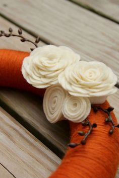 Autumn yarn wreath with felt rosette flowers