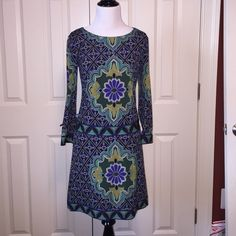 Beautiful Fitted Shift From Laundry Such a beautiful and fun fitted shift dress from Laundry by Shelli Segal.  The colors are fantastic.  I wore this dress only two times.  It's in new like condition. Laundry by Shelli Segal Dresses
