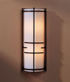 Hubbardton Forge 20-5910-10-C412 2 Light Extended Bars Wall Sconce  http://www.lightinguniverse.com/wall-sconces/hubbardton-forge-20-5910-2-light-extended-bars-wall-sconce_g141921.html?isku=792613=cataLogProductItemsImage#  $347