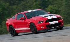 Right front view of a 2013 Shelby Mustang coupe in Race Red exterior paint, white stripes, and optional tarnished wheels. 2013 Shelby Gt500, Ford Mustang Shelby Gt500, Ford Shelby, Mustang Cars, 2013 Mustang Gt, 2015 Ford Mustang, Ford Mustang History, Pony Car, Pontiac Firebird