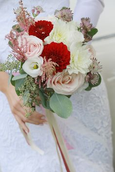 Romantic wedding bridal bouquet with dahlias and roses.