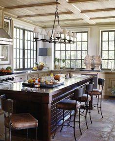 paneled ceiling, black steel windows, vintage barstools, and slate floors.  Elizabeth Tyler Kennedy.