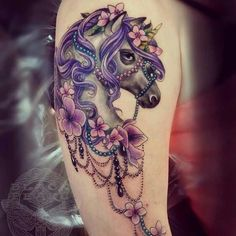 Magnificent looking unicorn tattoo. The unicorn is so well designed that you can definitely appreciate the small details added such as the glinting beads, the beautiful flowers and the intricate hairstyle on the unicorn.