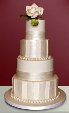 ivory pearlescent fondant wedding cake with ivory flower