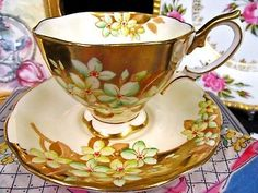 ROYAL ALBERT TEA CUP AND SAUCER BEADED FLORAL GOLD BAND TEACUP