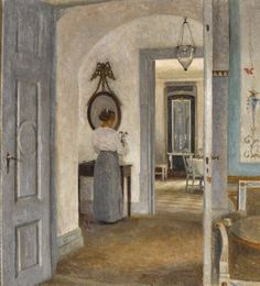 Peter Ilsted (Danish, 1861-1933), Interior with a Woman before a Mirror, Liselund, 1916. Oil on canvas, 66.5 x 62cm.