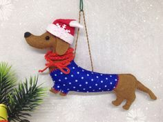 Dachshund felt dog ornament, Dog Christmas ornament, Gift for Dog Lover, Stuffed felt Dog ornament, Felt animals, Felt decoration for bags by SnowFelts on Etsy https://www.etsy.com/listing/553530386/dachshund-felt-dog-ornament-dog