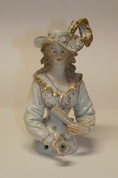 UNUSUAL HALF DOLL IN WHITE AND GOLD