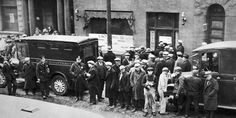 People gather in front of the infamous garage after the St Valentine's Day Massacre in 1929