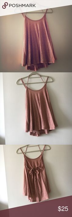 Small Free People Tank ❤️ Size small free people tank. Adjustable straps and tie in the back ! Super cute top. Perfect condition. Free People Tops Tank Tops
