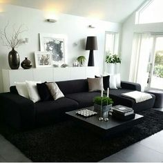 The black couch adds contrast to the white room by doesn't have a lot of balance to the large, black couch. Living Room Decor Cozy, Rooms Home Decor, Living Room Grey, Home Living Room, Apartment Living, Living Room Designs, Black Living Room Furniture, Black White And Grey Living Room, Black And White Living Room Decor