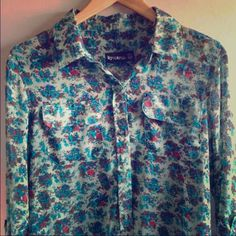Urban Outfitters floral blouse Great condition. Only worn once. Sheer mint green fabric with blue and dark red flowers. Size medium. Bought at Urban Outfitters; brand is Corpus. Urban Outfitters Tops Blouses