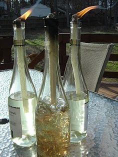"Keep the bugs away in a classy fashion! 1 empty and cleaned wine bottle 1 Tiki Torch wick refill (thick) Tiki Torch citronella fuel 3/8"" metal washer (or adjust washer size if bottle opening is larger/smaller) Decorative glass rocks or beads of your choice (optional) *small enough to fit in bottle opening - Click image to find more DIY & Crafts Pinterest pins"