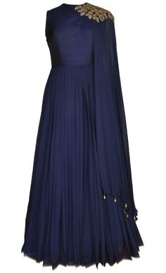 This set features a navy blue contemporary floor length suit in pure georgette base with a beautiful falling flare and has a sheer back. It features a navy blue silk yoke with a blend of light gold and gold dabka, gold zarkan and light sequins hand embroidery around the shoulder. It features an attached matching dupatta with gold tasseled hangings around the ends. It comes with a matching churidar pants. Get your hands on this truly contemporary designer creation and look exquisite this…