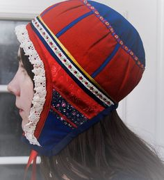 Europe | Portrait of a Saami girl wearing a traditional hat, Lapland, Scandinavia  #cap