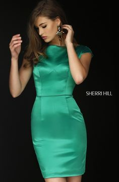 Sleek and sexy, the Sherri Hill 32295 short satin prom dress cleaves sensually to the figure. This simple jersey gown showcases a bateau neckline framed with cap sleeves and a full back. A barely perceptible seam curves beneath the bust and a slim line delineates the waistline. The fitted skirt finishes in a stylish above the knee hemline.