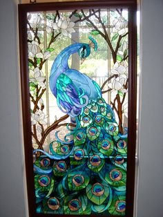 peacock stained glass door >> I'm pretty sure I wouldn't let anyone USE this as an entrance!